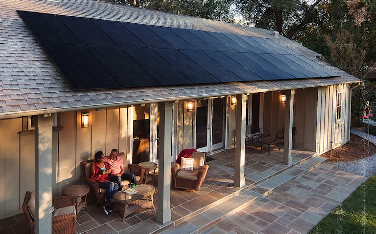 Photo of a house with all-black solar panels.