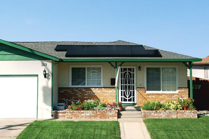 Photo of a brick house with solar panels.