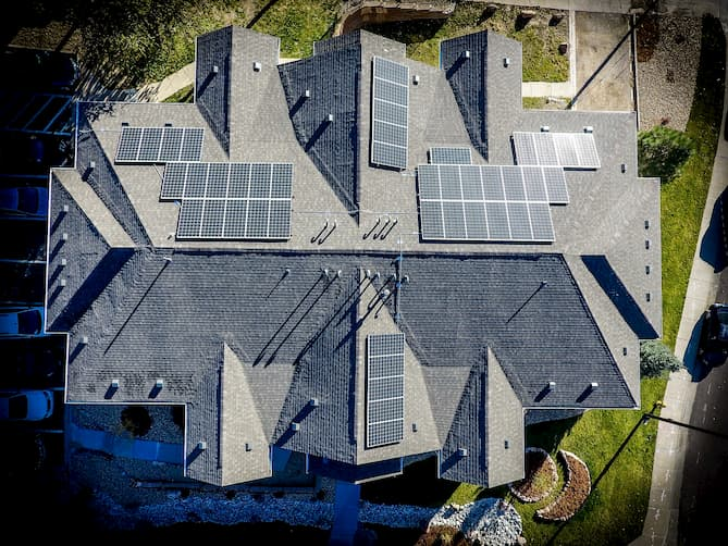 Photo of a large home with solar panels installed.