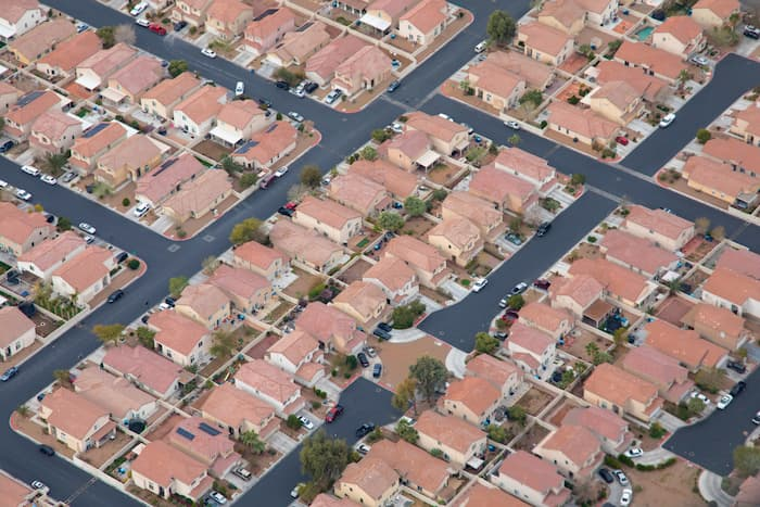 Aerial photo of some average size houses.