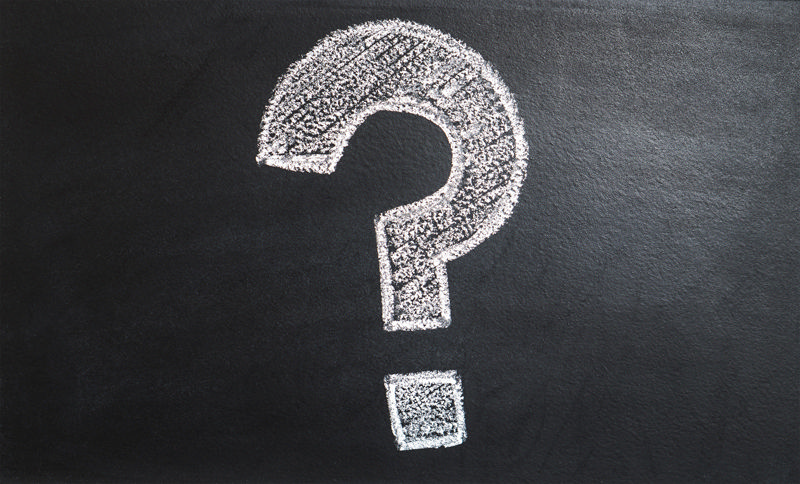 Image of a question mark on a blackboard.