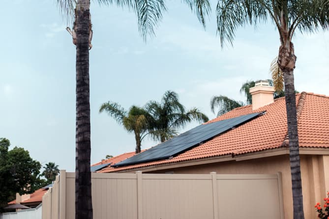 Photo of solar panels on a tile roof.