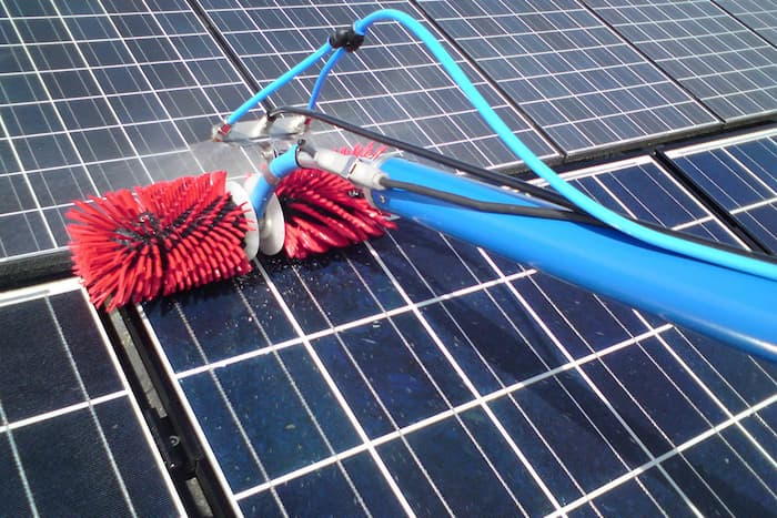 Cleaning solar panels.