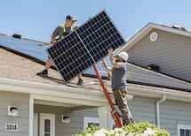 photo of a solar installers at work
